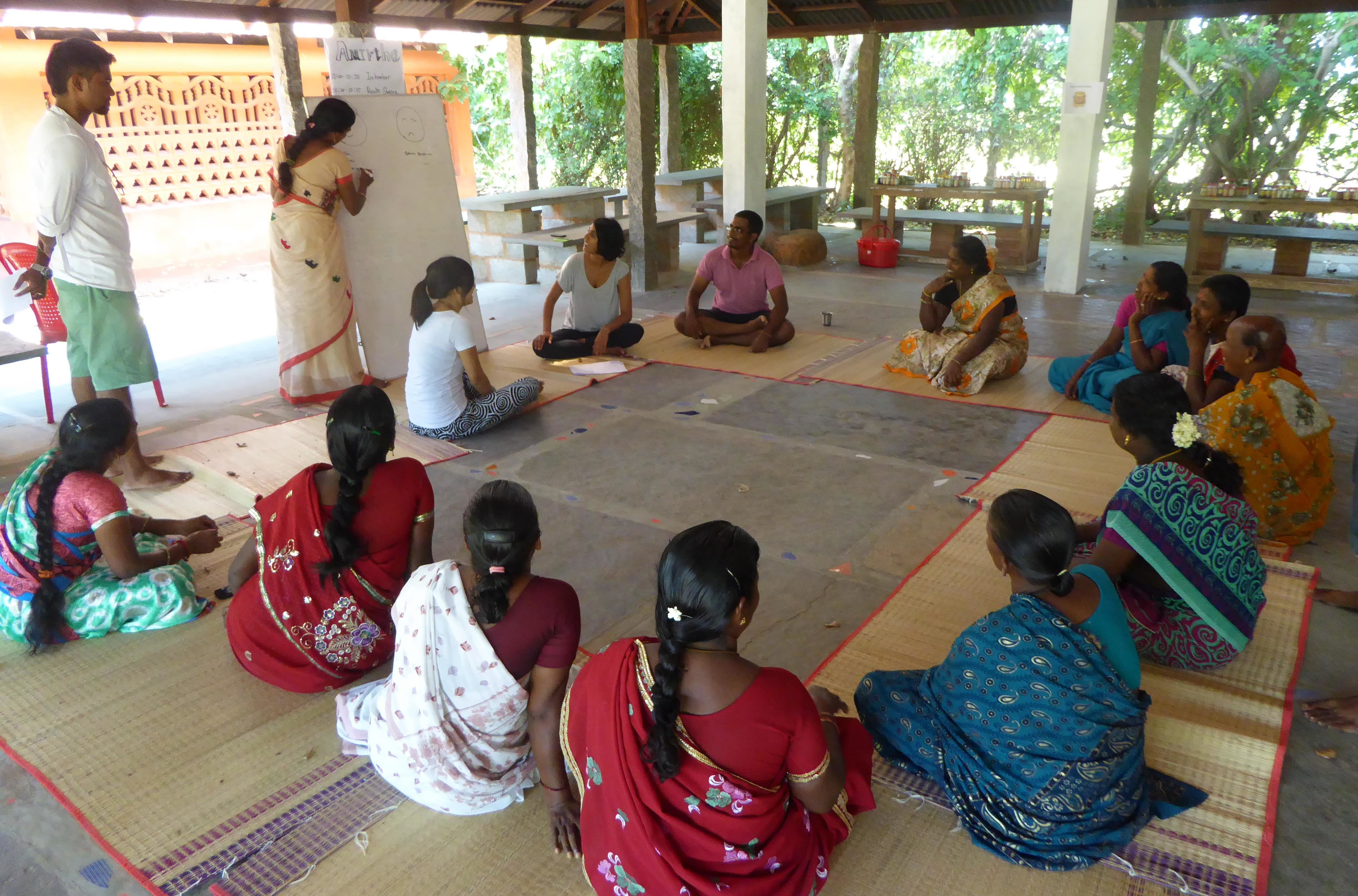 Skilled volunteers conducting a training session for local women's group to make a long term impact.